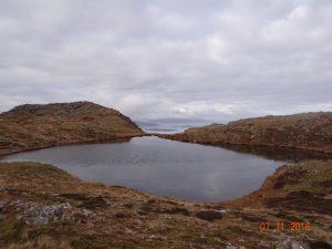 Summit lochan and Broadford Bay